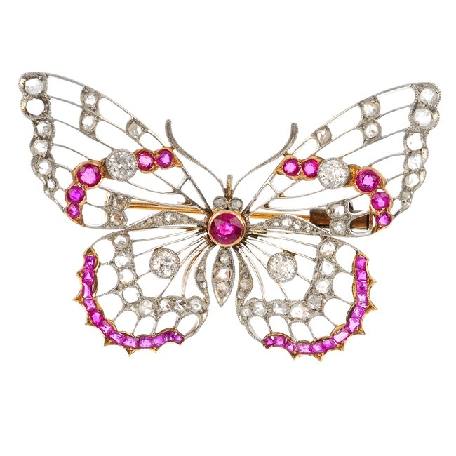 An early 20th century platinum and 18ct gold ruby and diamond butterfly brooch.