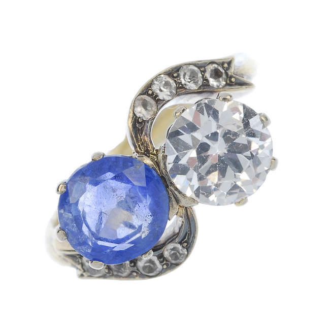 A mid 20th century 18ct gold sapphire two-stone crossover ring.