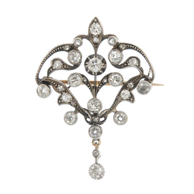 An early 20th century gold and silver diamond pendant.